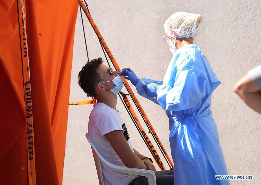 People wait to take COVID-19 tests in Sibenik, Croatia