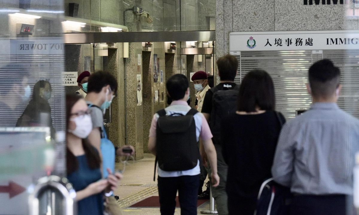 HK immigration employee detained for stealing, misusing personal info of police, others