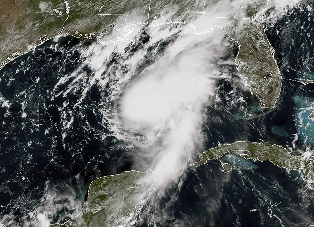 US Texas governor declares state of disaster as hurricane, tropical storm approach