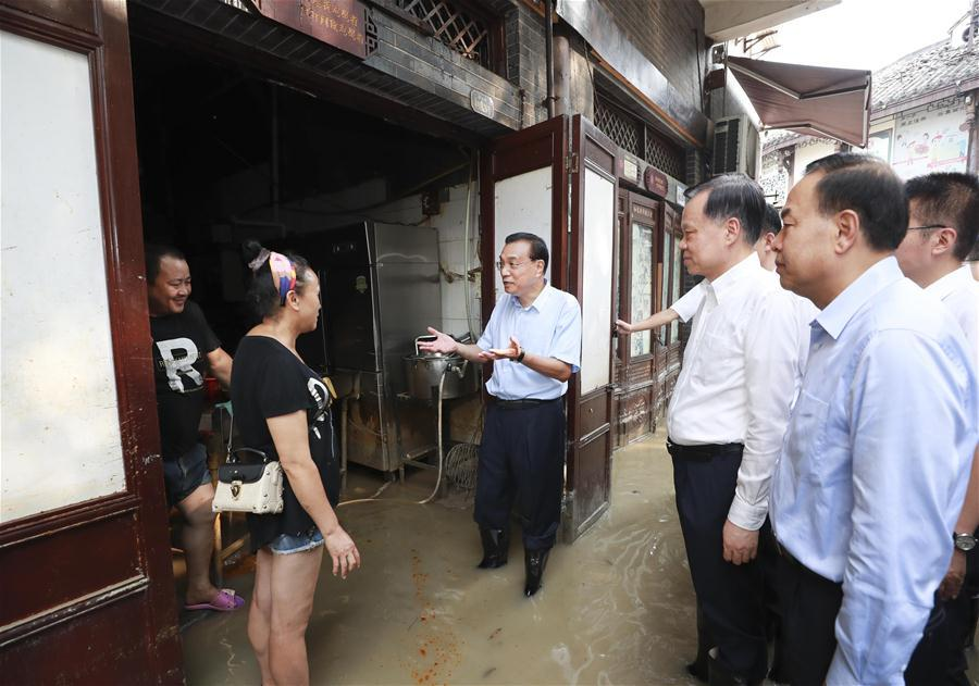 Chinese premier stresses flood control, consolidating economic recovery