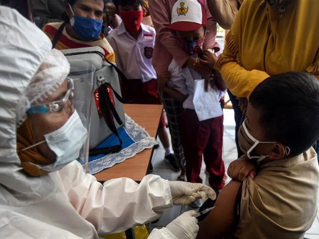 Students receive Measles-Rubella vaccine in Jakarta, Indonesia