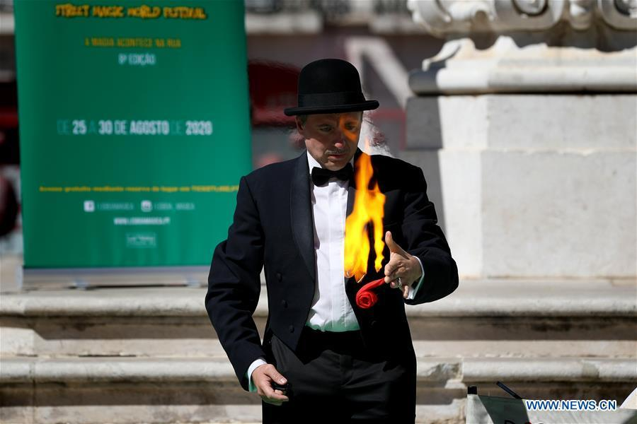 Magicians perform during Lisbon Street Magic World Festival in Portugal
