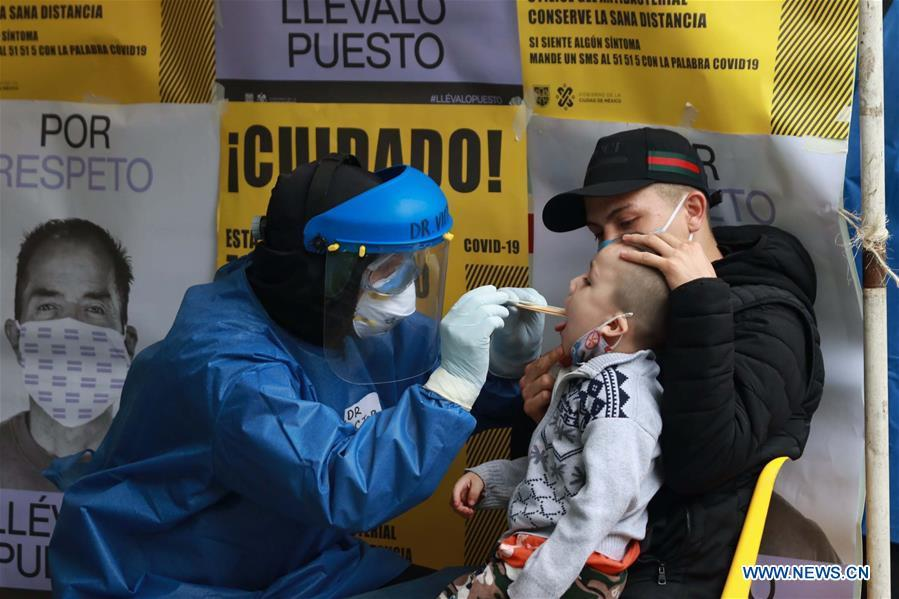 Medical workers take swab samples in Mexico City, Mexico