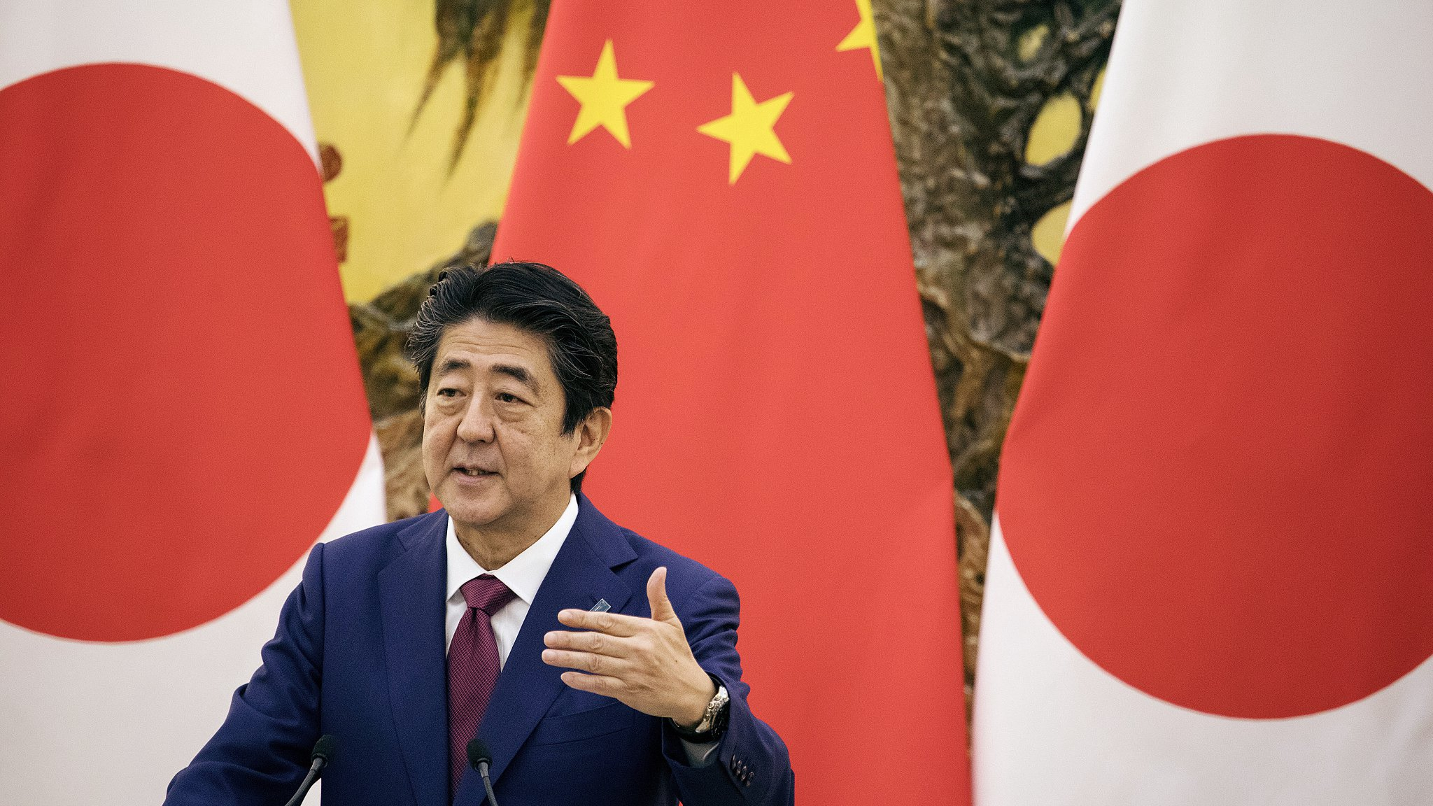 China vows to further improve Sino-Japanese ties amid Abe's resign