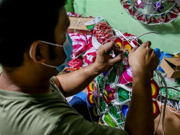 People arrange handicraft articles in Manila, the Philippines
