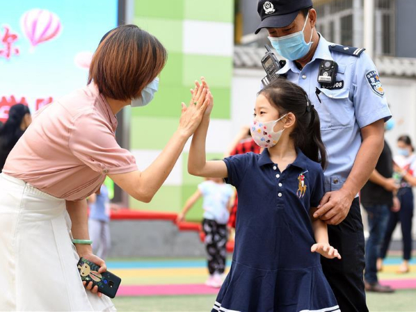 Students return to school as new semester starts in Beijing