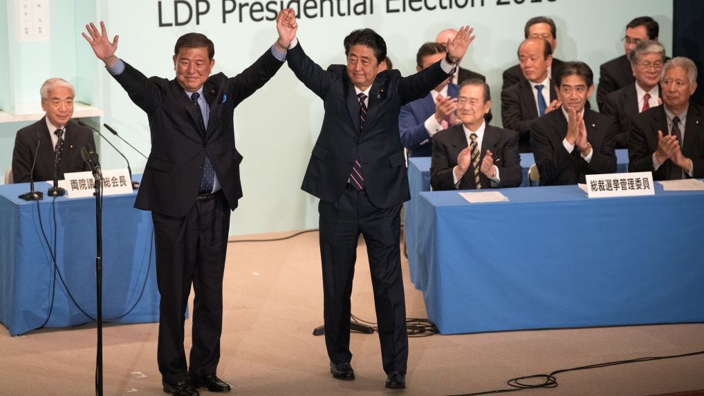 Ex-Japanese defense minister leads in polls to succeed Abe, but less popular within ruling party