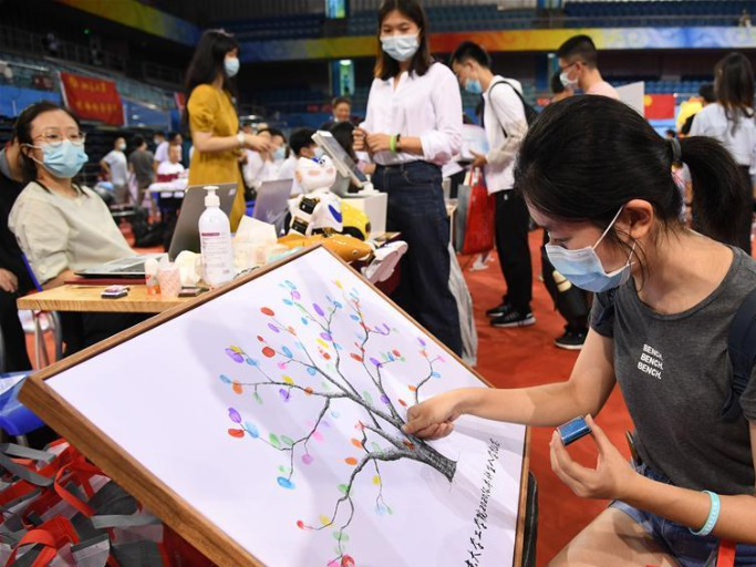 College students return to campus in Beijing as new school year starts