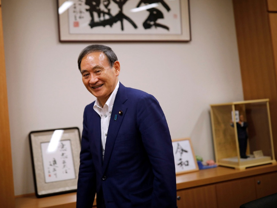 Largest faction of Japan's ruling party backs Suga to succeed Abe