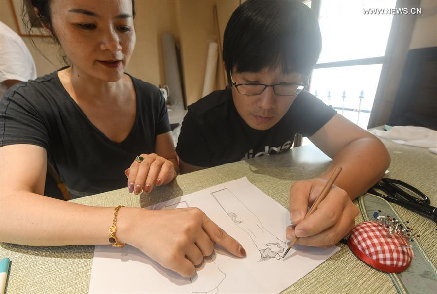 Pic story: cheongsam designer blends traditional style with modern taste