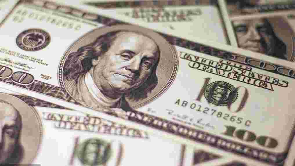 US dollar slips amid economic data