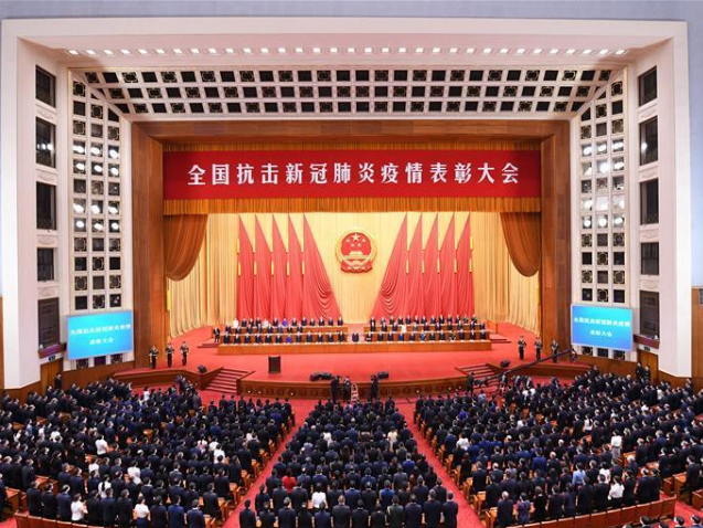 China holds meeting to commend COVID-19 fight role models