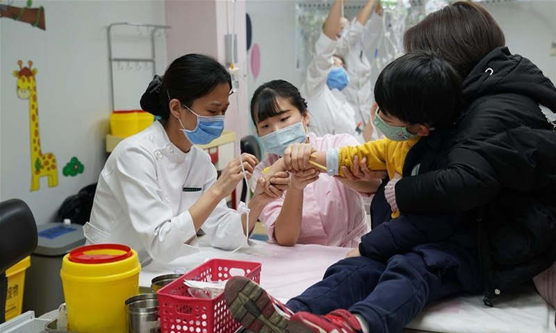 Beijing plans more, earlier flu shots to fend off COVID-19 cross-contraction