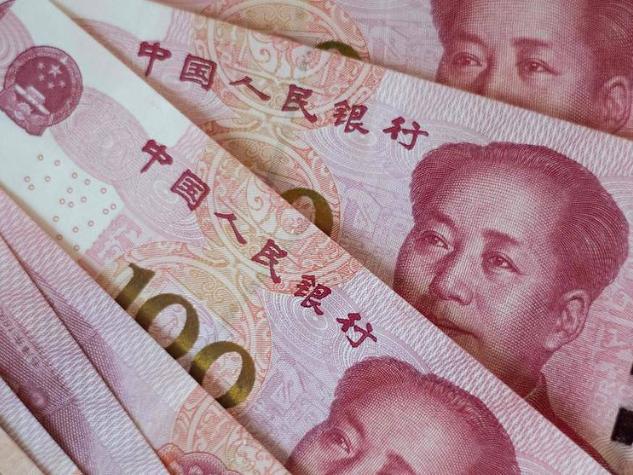 Yuan hits 16-month highs after China data, dollar falls