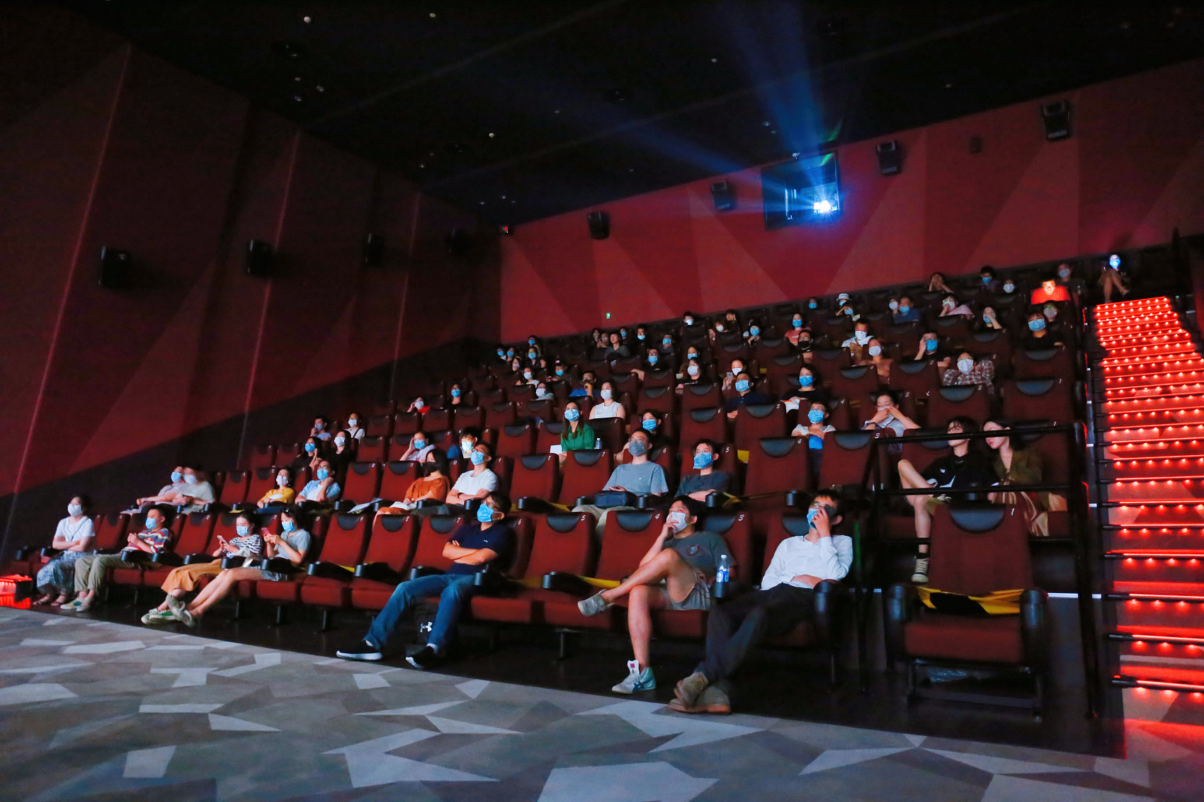 Chinese movie theaters raise attendance cap before holiday