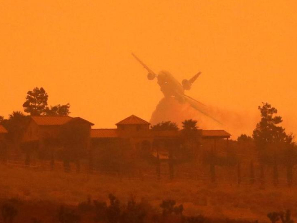Tanker drops fire retardant to battle wildfire in California