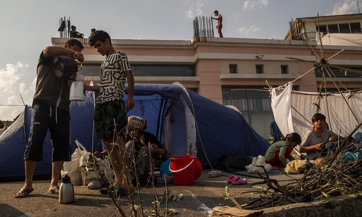 EU needs system of 'mandatory' solidarity on migration: commissioner