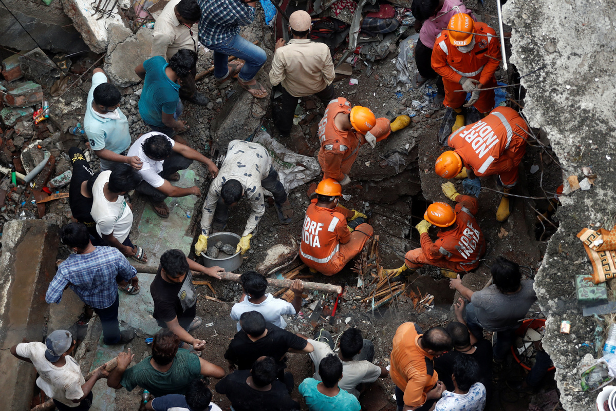 Death toll in building collapse in western India rises to 20, rescue continues