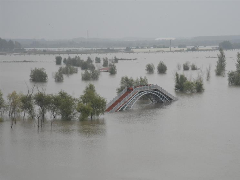 NE China river flood prone, water traffic suspended