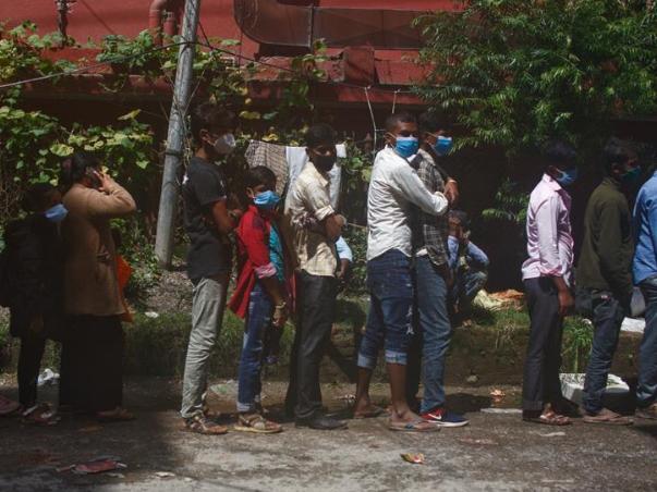 Migrant workers wait for COVID-19 test in Kathmandu, Nepal