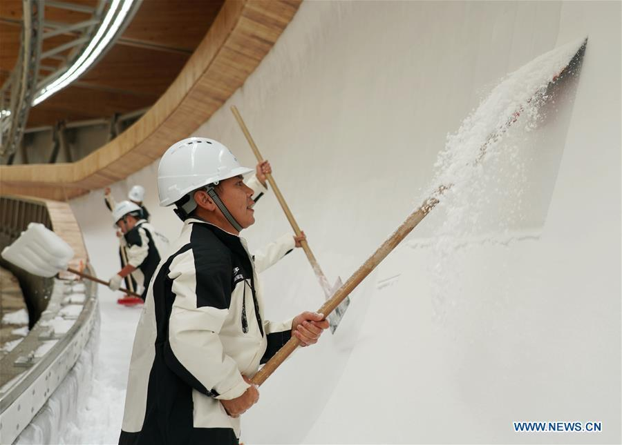 Ice-making work underway at National Sliding Center in Yanqing of Beijing
