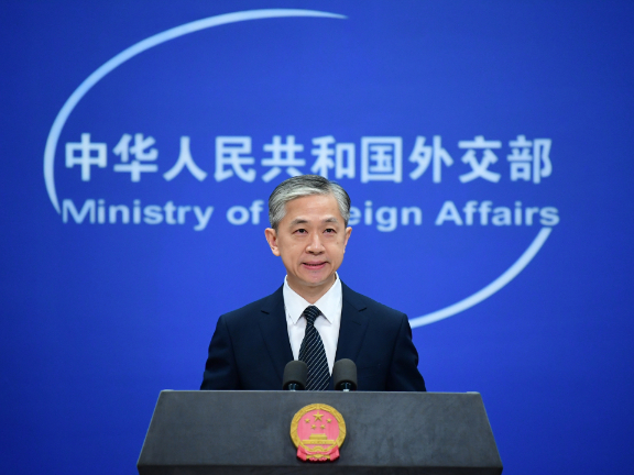 China urges US to respect market economy, fair competition principles