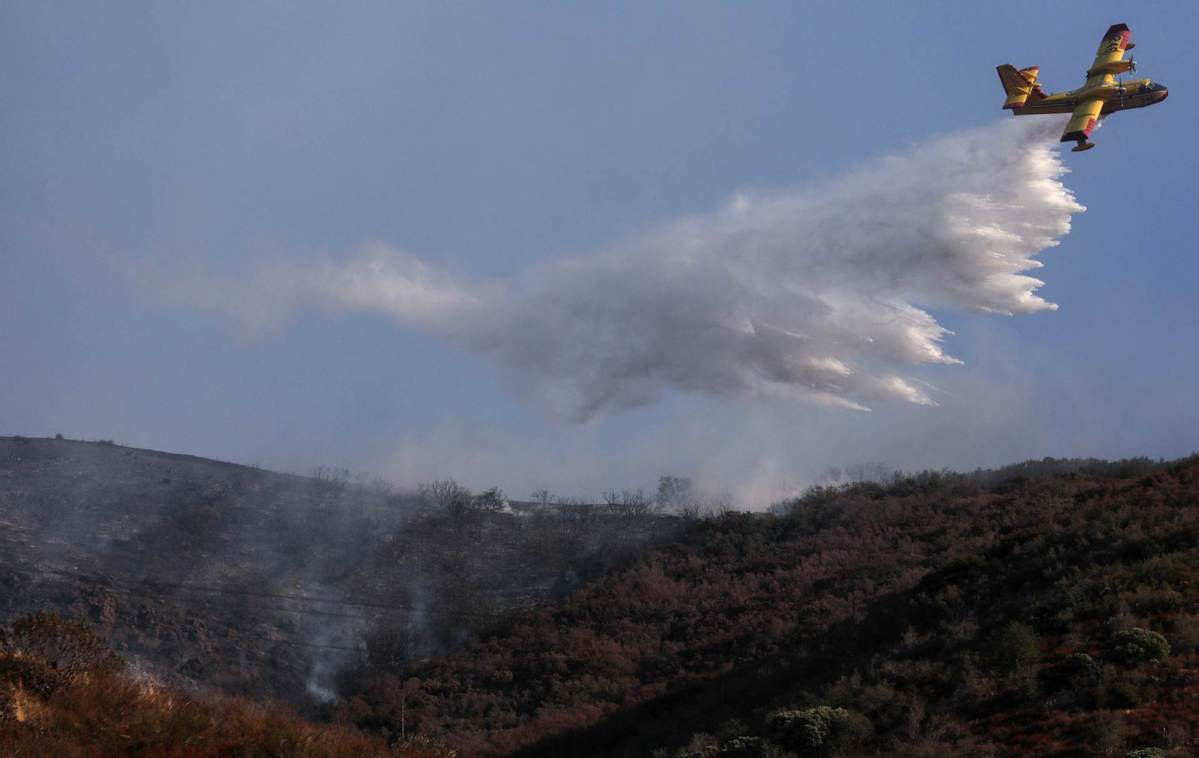 California wildfires burn 3.75 mln acres with 26 fatalities