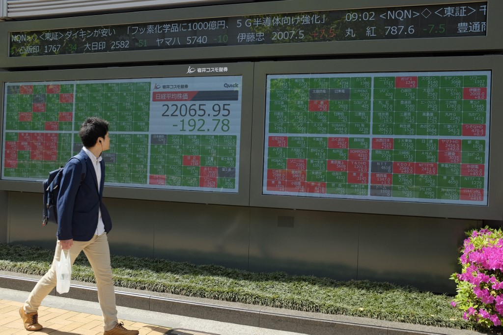 Tokyo stocks down after Trump tests positive for COVID