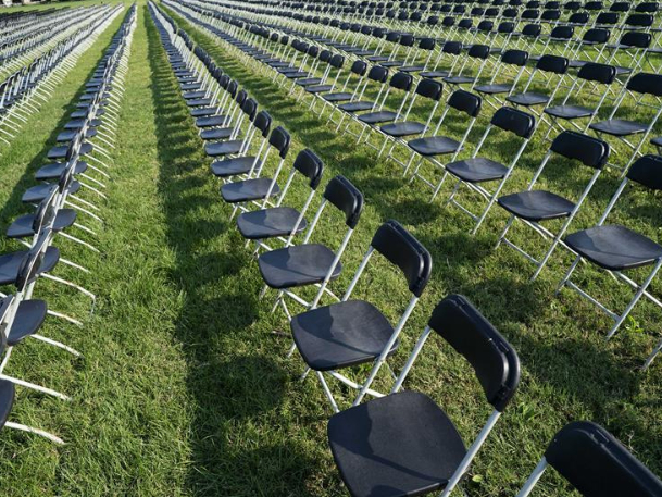 Empty chairs sit on Ellipse near White House in remembrance of those killed by COVID-19
