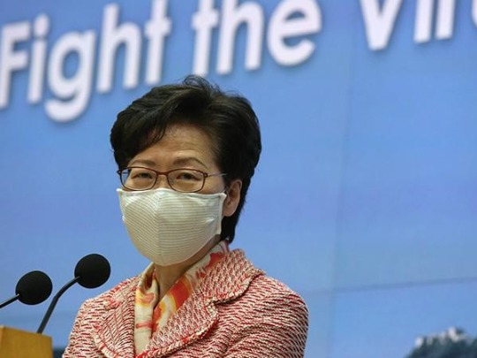 Lam backs primary school teacher's disqualification
