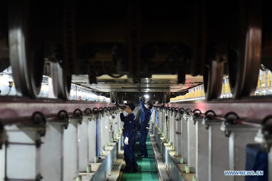 Railway staff members step up maintenance of high-speed trains