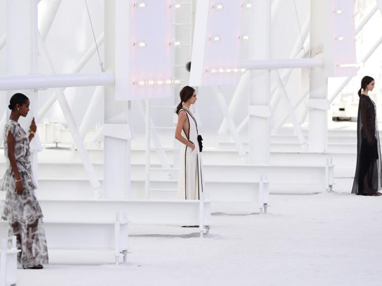 Models present creations by Chanel during Paris Fashion Week