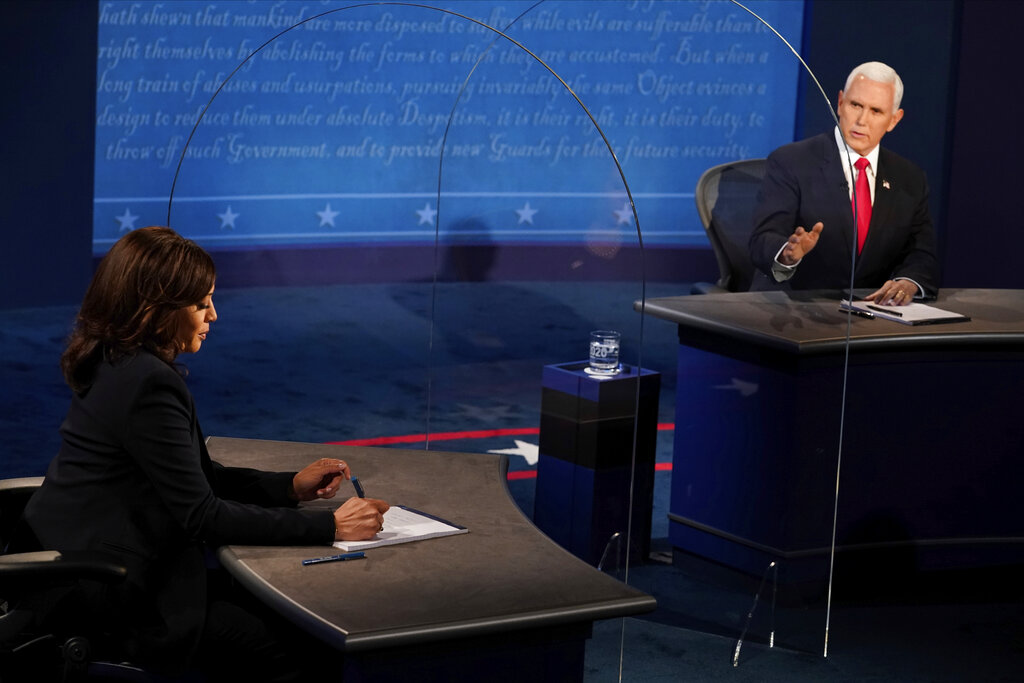 The Latest: VP debate more cordial than presidential debate