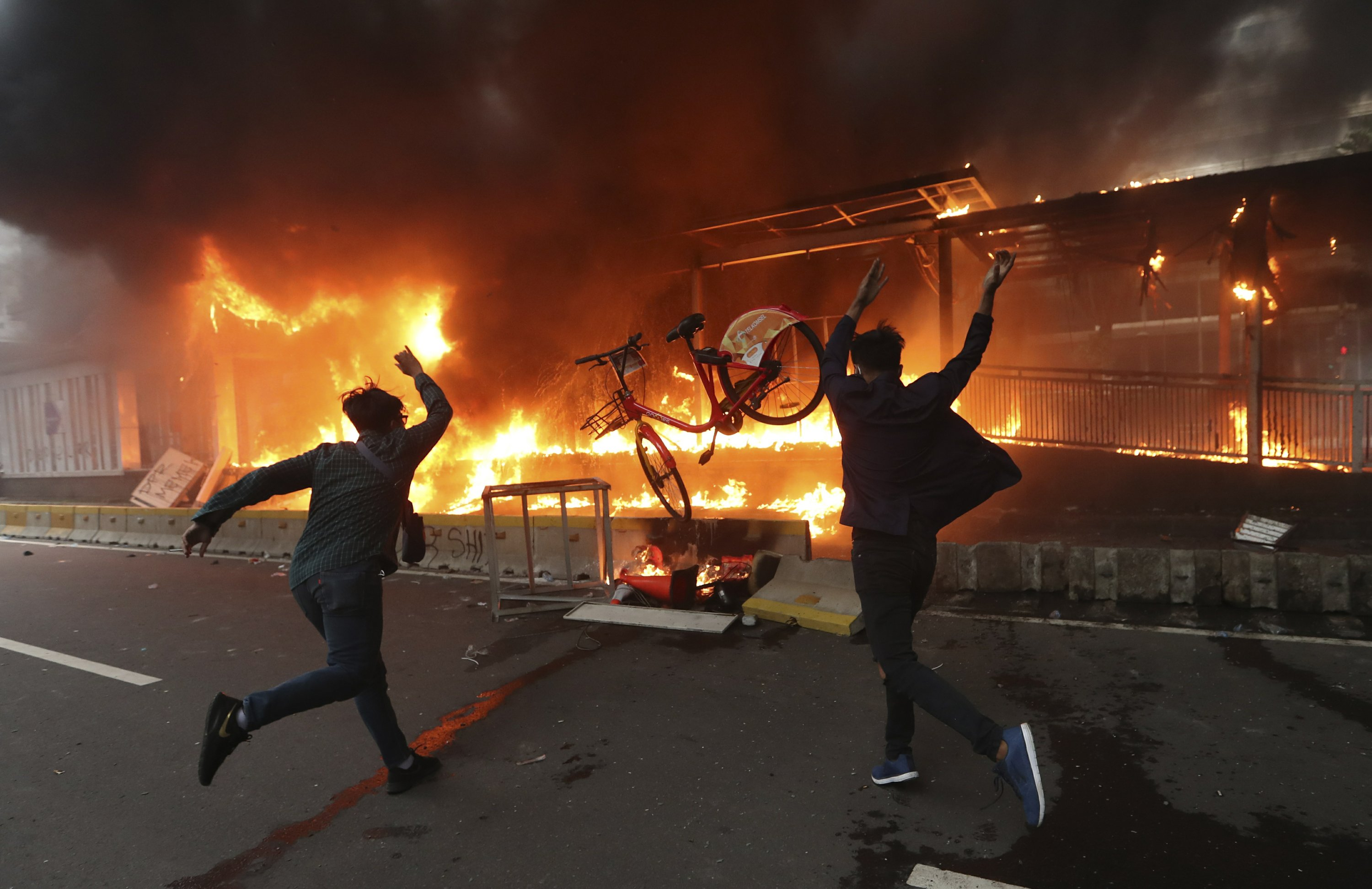 Protests against new labor law turn violent across Indonesia