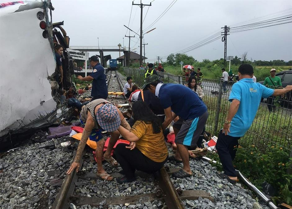 At least 17 dead in Thailand bus-train collision