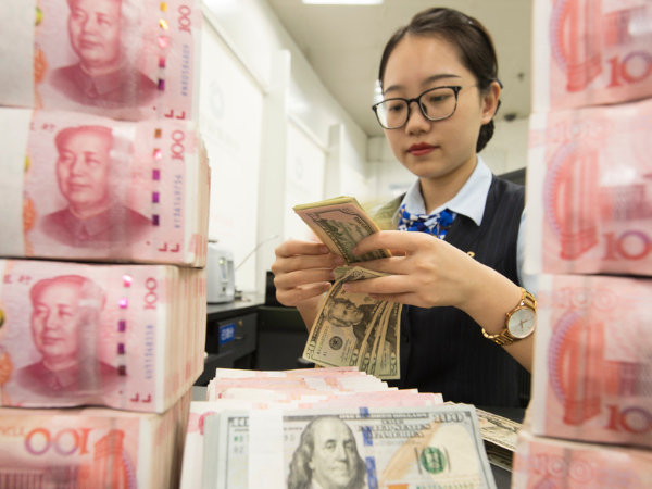 Chinese yuan strengthens to 6.7126 against USD on Monday
