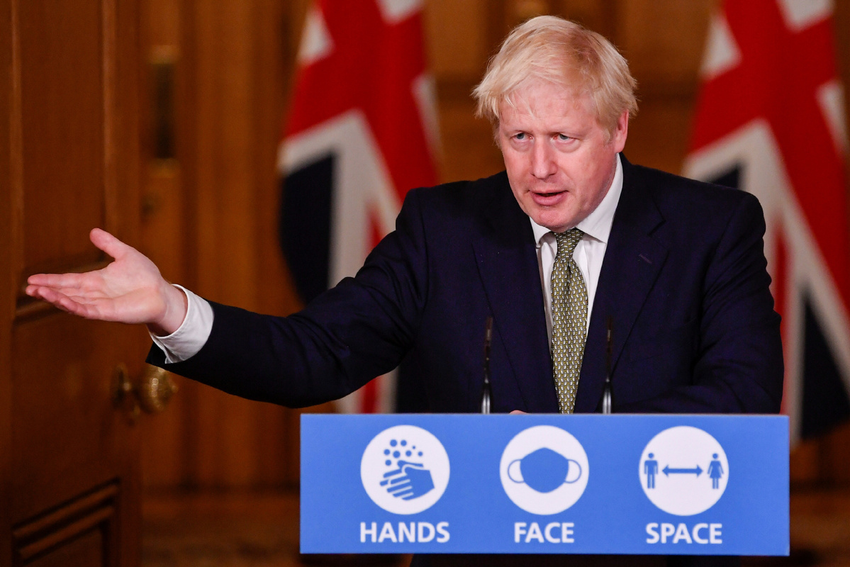 Boris Johnson criticized as local virus lockdowns loom for UK