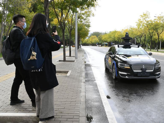 Baidu launches program in Beijing to offer free trials of its self-driving taxi service