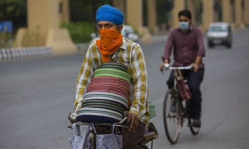 Severe air pollution adds to New Delhi's challenges in fight against COVID-19