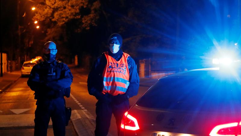 Police shoot man dead after teacher killed in Paris suburb