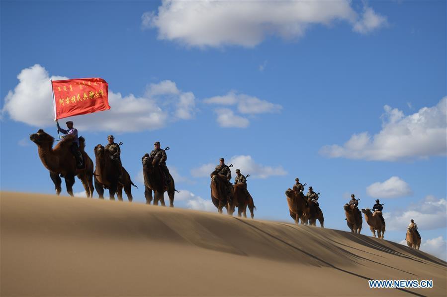 Militiamen attend camel-back field training in Inner Mongolia