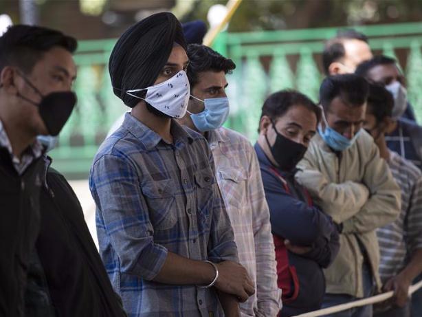 People take COVID-19 rapid antigen tests in Srinagar city