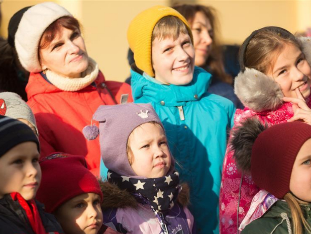 People watch performance during parade in St. Petersburg, Russia