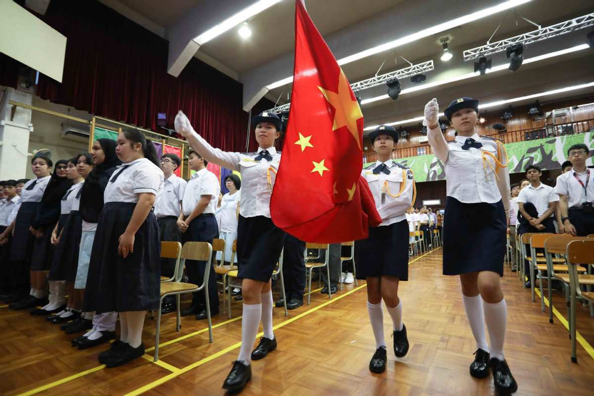 Hong Kong schools to standardize education on national flag, emblem