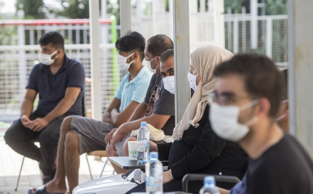 New restrictions in Europe as global virus cases pass 40 million