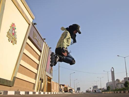 Palestinian girl roller-skates on street in Gaza City