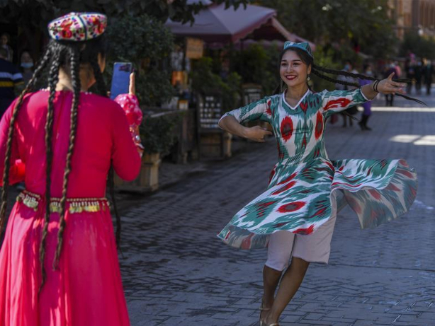 China's Xinjiang issues report on employment of ethnic groups