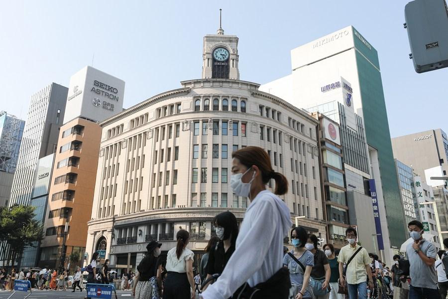 Tokyo stocks open lower as key US stimulus talks reach 11th hour