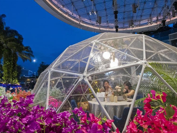 People dine inside dome at Capitol Singapore Outdoor Plaza
