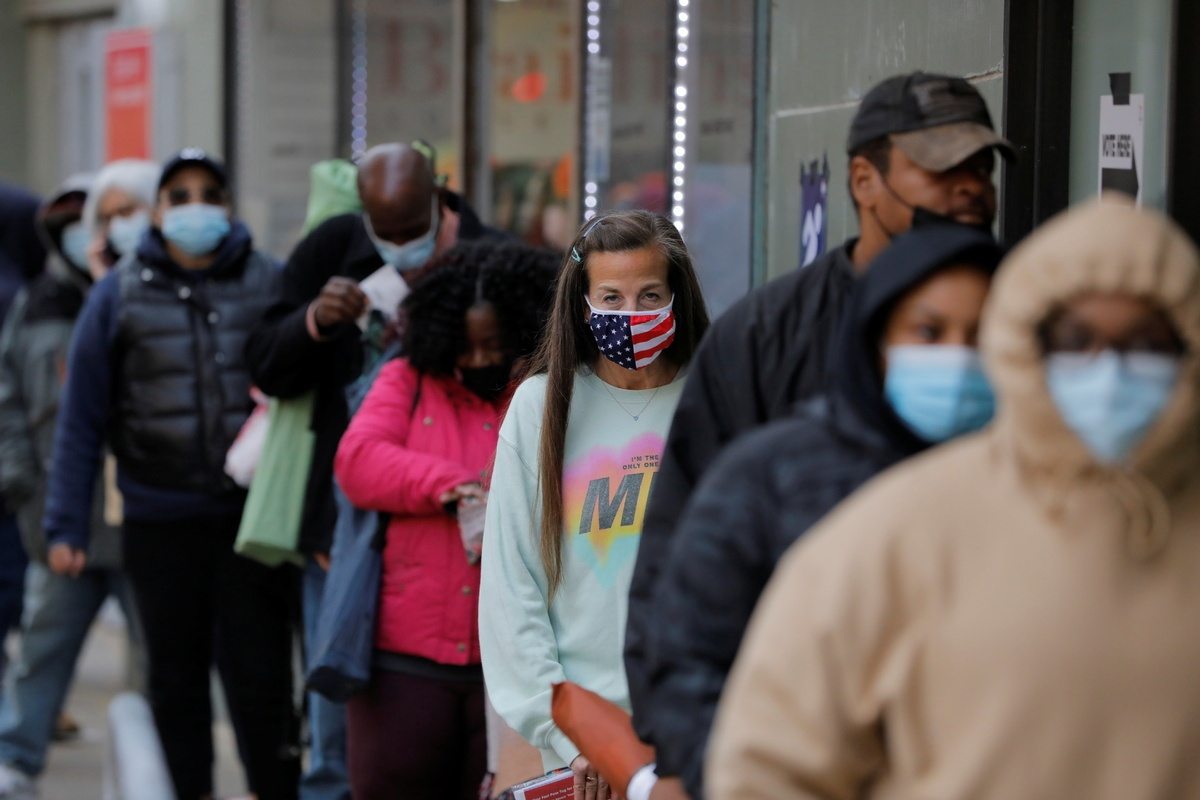 Virus surge sharpens choice for US voters